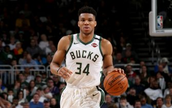 MILWAUKEE, WI - FEBRUARY 2: Giannis Antetokounmpo #34 of the Milwaukee Bucks handles the ball during a game against the Phoenix Suns on February 2, 2020 at the Fiserv Forum Center in Milwaukee, Wisconsin. NOTE TO USER: User expressly acknowledges and agrees that, by downloading and or using this Photograph, user is consenting to the terms and conditions of the Getty Images License Agreement. Mandatory Copyright Notice: Copyright 2020 NBAE (Photo by Gary Dineen/NBAE via Getty Images).