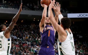 MILWAUKEE, WI - FEBRUARY 2: Devin Booker #1 of the Phoenix Suns shoots the ball during a game against the Milwaukee Bucks on February 2, 2020 at the Fiserv Forum Center in Milwaukee, Wisconsin. NOTE TO USER: User expressly acknowledges and agrees that, by downloading and or using this Photograph, user is consenting to the terms and conditions of the Getty Images License Agreement. Mandatory Copyright Notice: Copyright 2020 NBAE (Photo by Gary Dineen/NBAE via Getty Images).