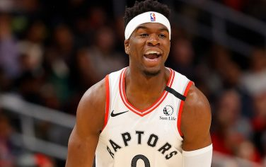 ATLANTA, GEORGIA - JANUARY 20:  Terence Davis #0 of the Toronto Raptors reacts after hitting a three-point basket against the Atlanta Hawks in the second half at State Farm Arena on January 20, 2020 in Atlanta, Georgia.  NOTE TO USER: User expressly acknowledges and agrees that, by downloading and/or using this photograph, user is consenting to the terms and conditions of the Getty Images License Agreement.  (Photo by Kevin C. Cox/Getty Images)