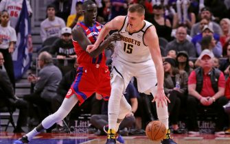 DETROIT, MI - FEBRUARY 2: Nikola Jokic #15 of the Denver Nuggets looks to drive the ball as Thon Maker #7 of the Detroit Pistons defends during the fourth quarter of the game at Little Caesars Arena on February 2, 2020 in Detroit, Michigan. Detroit defeated Denver 28-123. NOTE TO USER: User expressly acknowledges and agrees that, by downloading and or using this photograph, User is consenting to the terms and conditions of the Getty Images License Agreement (Photo by Leon Halip/Getty Images) *** Local Caption *** Nikola Jokic; Thon Maker