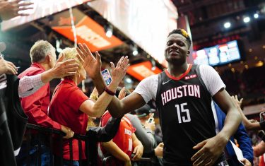 HOUSTON, TX - NOVEMBER 18: Clint Capela #15 of the Houston Rockets high fives the fans after the game against the Portland Trail Blazers on November 18, 2019 at the Toyota Center in Houston, Texas. NOTE TO USER: User expressly acknowledges and agrees that, by downloading and or using this photograph, User is consenting to the terms and conditions of the Getty Images License Agreement. Mandatory Copyright Notice: Copyright 2019 NBAE (Photo by Cato Cataldo/NBAE via Getty Images)