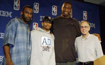 PHILADELPHIA, :  Posing for a group photo following a ceremony where  Philadelphia 76ers head coach Larry Brown (R), was presented the Red Auerbach trophy after being named the NBA Head Coach of the Year, are from the left, Phildelphia 76ers Aaron McKie, the recipient of the NBA's Sixth Man Award; Allen Iverson, the NBA's Most Valuable Player and Dikembe Mutombo, the NBA Defensive Player of the Year. This is the first time in the NBA's history that all four major awards were presented to players and a coach on the same team. The ceremeony was held 23 May 2001, in Philadelphia. AFP PHOTO/ TOM MIHALEK (Photo credit should read TOM MIHALEK/AFP via Getty Images)