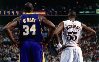 PHILADELPHIA - JUNE 15:  Shaquille O'Neal #34 of the Los Angeles Lakers matches up against Dikembe Mutombo #55 of the Philadelphia 76ers during game five of the 2001 NBA Finals at First Union Center on June 15, 2001 in Philadelphia, Pennsylvania.  NOTE TO USER: User expressly acknowledges that, by downloading and or using this photograph, User is consenting to the terms and conditions of the Getty Images License agreement. Mandatory Copyright Notice: Copyright 2001 NBAE (Photo by Jesse D. Garrabrant/NBAE via Getty Images)
