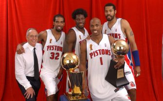 AUBURN HILLS, MI - JUNE 15: (L-R)  Larry Brown, Richard Hamilton #32, Ben Wallace #3, Chauncey Billups #1 (holding his Finals MVP Trophy) and Rasheed Wallace #30 of the Detroit Pistons pose for a portrait with the NBA Championship Trophy after winning the 2004 NBA Championship against the Los Angeles Lakers on June 15, 2004 at the Palace of Auburn Hills in Auburn Hills, Michigan.  NOTE TO USER: User expressly acknowledges and agrees that, by downloading and/or using this Photograph, User is consenting to the terms and conditions of the Getty Images License Agreement.  (Photo by Andrew D. Bernstein/NBAE via Getty Images)