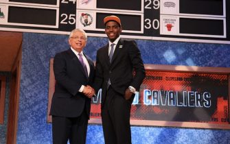 NEWARK, NJ - JUNE 23: Kyrie Irving shakes hands with NBA Commissioner David Stern after being selected number one overall by the Cleveland Cavaliers during the 2011 NBA Draft Presented by KIA at the Prudential Center on June 23, 2011 in Newark, New Jersey. NOTE TO USER: User expressly acknowledges and agrees that, by downloading and or using this photograph, User is consenting to the terms and conditions of the Getty Images License Agreement. Mandatory Copyright Notice: Copyright 2011 NBAE (Photo by Nathaniel S. Butler/NBAE via Getty Images)