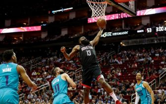 HOUSTON, TEXAS - FEBRUARY 04: James Harden #13 of the Houston Rockets drives to the basket defended by Cody Martin #11 of the Charlotte Hornets in the first half at Toyota Center on February 04, 2020 in Houston, Texas.  NOTE TO USER: User expressly acknowledges and agrees that, by downloading and or using this photograph, User is consenting to the terms and conditions of the Getty Images License Agreement. (Photo by Tim Warner/Getty Images)