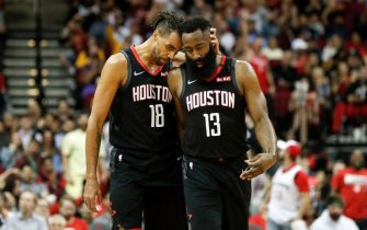 HOUSTON, TEXAS - FEBRUARY 04: James Harden #13 of the Houston Rockets is congratulated by Thabo Sefolosha #18 after a three point shot in the second half against the Charlotte Hornets at Toyota Center on February 04, 2020 in Houston, Texas.  NOTE TO USER: User expressly acknowledges and agrees that, by downloading and or using this photograph, User is consenting to the terms and conditions of the Getty Images License Agreement. (Photo by Tim Warner/Getty Images)