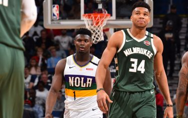 NEW ORLEANS, LA - FEBRUARY 4: Zion Williamson #1 of the New Orleans Pelicans and Giannis Antetokounmpo #34 of the Milwaukee Bucks look on during a game on February 4, 2020 at the Smoothie King Center in New Orleans, Louisiana. NOTE TO USER: User expressly acknowledges and agrees that, by downloading and or using this Photograph, user is consenting to the terms and conditions of the Getty Images License Agreement. Mandatory Copyright Notice: Copyright 2020 NBAE (Photo by Jesse D. Garrabrant/NBAE via Getty Images)
