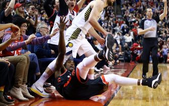 TORONTO, ON - FEBRUARY 05:  Serge Ibaka #9 of the Toronto Raptors is knocked down by Domantas Sabonis #11 of the Indiana Pacers after sinking the game-winning three pointer during the second half of an NBA game at Scotiabank Arena on February 05, 2020 in Toronto, Canada. The Raptors defeated the Pacers 119-118.  NOTE TO USER: User expressly acknowledges and agrees that, by downloading and or using this photograph, User is consenting to the terms and conditions of the Getty Images License Agreement.  (Photo by Vaughn Ridley/Getty Images)