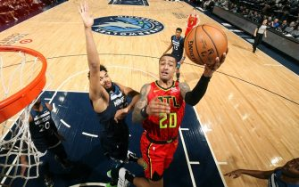 MINNEAPOLIS, MN -  FEBRUARY 5: John Collins #20 of the Atlanta Hawks drives to the basket against the Minnesota Timberwolves on February 5, 2020 at Target Center in Minneapolis, Minnesota. NOTE TO USER: User expressly acknowledges and agrees that, by downloading and or using this Photograph, user is consenting to the terms and conditions of the Getty Images License Agreement. Mandatory Copyright Notice: Copyright 2020 NBAE (Photo by David Sherman/NBAE via Getty Images)