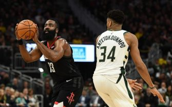 MILWAUKEE, WISCONSIN - MARCH 26:  James Harden #13 of the Houston Rockets is defended by Giannis Antetokounmpo #34 of the Milwaukee Bucks during a game at Fiserv Forum on March 26, 2019 in Milwaukee, Wisconsin. NOTE TO USER: User expressly acknowledges and agrees that, by downloading and or using this photograph, User is consenting to the terms and conditions of the Getty Images License Agreement. (Photo by Stacy Revere/Getty Images)
