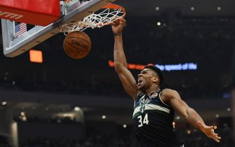 MILWAUKEE, WISCONSIN - FEBRUARY 06:  Giannis Antetokounmpo #34 of the Milwaukee Bucks dunks against the Philadelphia 76ers during the first half of a game at Fiserv Forum on February 06, 2020 in Milwaukee, Wisconsin. NOTE TO USER: User expressly acknowledges and agrees that, by downloading and or using this photograph, User is consenting to the terms and conditions of the Getty Images License Agreement. (Photo by Stacy Revere/Getty Images)