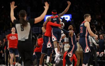 WASHINGTON, DC - FEBRUARY 07: Bradley Beal #3 of the Washington Wizards celebrates with teammates after scoring the game-winning basket in front of Delon Wright #55 of the Dallas Mavericks during the second half at Capital One Arena on February 07, 2020 in Washington, DC. NOTE TO USER: User expressly acknowledges and agrees that, by downloading and or using this photograph, User is consenting to the terms and conditions of the Getty Images License Agreement. (Photo by Patrick Smith/Getty Images)