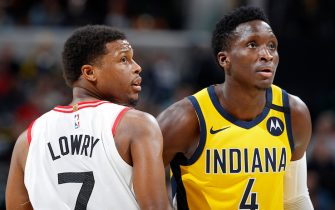 INDIANAPOLIS, IN - FEBRUARY 07: Victor Oladipo #4 of the Indiana Pacers looks on alongside Kyle Lowry #7 of the Toronto Raptors in the first half of a game at Bankers Life Fieldhouse on February 7, 2020 in Indianapolis, Indiana. NOTE TO USER: User expressly acknowledges and agrees that, by downloading and or using this Photograph, user is consenting to the terms and conditions of the Getty Images License Agreement. (Photo by Joe Robbins/Getty Images)