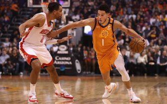 PHOENIX, ARIZONA - FEBRUARY 07: Devin Booker #1 of the Phoenix Suns handles the ball guarded by Thabo Sefolosha #18 of the Houston Rockets during the second half of the NBA game at Talking Stick Resort Arena on February 07, 2020 in Phoenix, Arizona. NOTE TO USER: User expressly acknowledges and agrees that, by downloading and or using this photograph, user is consenting to the terms and conditions of the Getty Images License Agreement. Mandatory Copyright Notice: Copyright 2020 NBAE. (Photo by Christian Petersen/Getty Images)