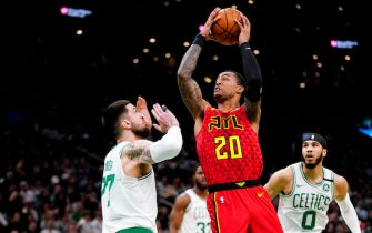 BOSTON, MASSACHUSETTS - FEBRUARY 07: John Collins #20 of the Atlanta Hawks drives to the basket during the first quarter of the game against the Boston Celtics at TD Garden on February 07, 2020 in Boston, Massachusetts. NOTE TO USER: User expressly acknowledges and agrees that, by downloading and or using this photograph, User is consenting to the terms and conditions of the Getty Images License Agreement. (Photo by Omar Rawlings/Getty Images)
