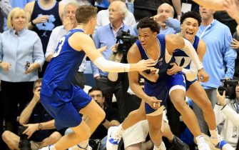 CHAPEL HILL, NORTH CAROLINA - FEBRUARY 08: Wendell Moore Jr. #0 of the Duke Blue Devils reacts after making the game winning shot to defeat the North Carolina Tar Heels 98-96 with teammates Joey Baker #13 and Jordan Goldwire #14 during their game at Dean Smith Center on February 08, 2020 in Chapel Hill, North Carolina. (Photo by Streeter Lecka/Getty Images)