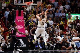 MIAMI, FL - JANUARY 08:  Nikola Jokic #15 of the Denver Nuggets makes a shot with 2.4 seconds remaining in the game against the Miami Heat at American Airlines Arena on January 8, 2019 in Miami, Florida. NOTE TO USER: User expressly acknowledges and agrees that, by downloading and or using this photograph, User is consenting to the terms and conditions of the Getty Images License Agreement.  (Photo by Michael Reaves/Getty Images)