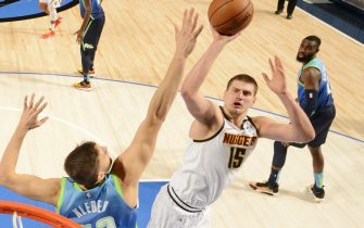 DALLAS, TX - JANUARY 8: Nikola Jokic #15 of the Denver Nuggets shoots the ball against the Dallas Mavericks on January 8, 2020 at the American Airlines Center in Dallas, Texas. NOTE TO USER: User expressly acknowledges and agrees that, by downloading and or using this photograph, User is consenting to the terms and conditions of the Getty Images License Agreement. Mandatory Copyright Notice: Copyright 2020 NBAE (Photo by Glenn James/NBAE via Getty Images)
