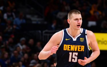 DENVER, CO - JANUARY 30: Nikola Jokic #15 of the Denver Nuggets reacts to a play during the game against the Utah Jazz on January 30, 2020 at the Pepsi Center in Denver, Colorado. NOTE TO USER: User expressly acknowledges and agrees that, by downloading and/or using this Photograph, user is consenting to the terms and conditions of the Getty Images License Agreement. Mandatory Copyright Notice: Copyright 2020 NBAE (Photo by Bart Young/NBAE via Getty Images)
