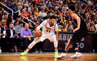 PHOENIX, AZ - FEBRUARY 8: Jamal Murray #27 of the Denver Nuggets handles the ball against the Phoenix Suns on February 08, 2020 at Talking Stick Resort Arena in Phoenix, Arizona. NOTE TO USER: User expressly acknowledges and agrees that, by downloading and or using this photograph, user is consenting to the terms and conditions of the Getty Images License Agreement. Mandatory Copyright Notice: Copyright 2020 NBAE (Photo by Barry Gossage/NBAE via Getty Images)