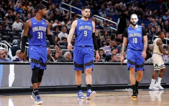ORLANDO, FL - FEBRUARY 8: Terrence Ross #31, Nikola Vucevic #9 and Evan Fournier #10 of the Orlando Magic return to the floor after a time-out during the game against the Milwaukee Bucks at the Amway Center on February 8, 2020 in Orlando, Florida. The Bucks defeated the Magic 112 to 95. NOTE TO USER: User expressly acknowledges and agrees that, by downloading and or using this photograph, User is consenting to the terms and conditions of the Getty Images License Agreement. (Photo by Don Juan Moore/Getty Images)