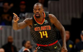 ATLANTA, GEORGIA - FEBRUARY 09:  Dewayne Dedmon #14 of the Atlanta Hawks reacts after dunking against the New York Knicks in the first half at State Farm Arena on February 09, 2020 in Atlanta, Georgia.  NOTE TO USER: User expressly acknowledges and agrees that, by downloading and/or using this photograph, user is consenting to the terms and conditions of the Getty Images License Agreement.  (Photo by Kevin C. Cox/Getty Images)