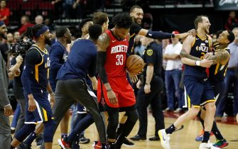 HOUSTON, TEXAS - FEBRUARY 09: Robert Covington #33 of the Houston Rockets reacts as the Utah Jazz celebrate after a game winning shot by Bojan Bogdanovic #44 at Toyota Center on February 09, 2020 in Houston, Texas.  NOTE TO USER: User expressly acknowledges and agrees that, by downloading and or using this photograph, User is consenting to the terms and conditions of the Getty Images License Agreement. (Photo by Tim Warner/Getty Images)