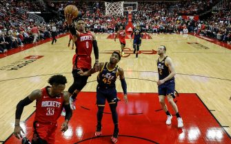 HOUSTON, TEXAS - FEBRUARY 09: Russell Westbrook #0 of the Houston Rockets drives to the basket defended by Donovan Mitchell #45 of the Utah Jazz in the first half at Toyota Center on February 09, 2020 in Houston, Texas.  NOTE TO USER: User expressly acknowledges and agrees that, by downloading and or using this photograph, User is consenting to the terms and conditions of the Getty Images License Agreement. (Photo by Tim Warner/Getty Images)