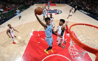 WASHINGTON, DC - FEBRUARY 9:  Ja Morant #12 of the Memphis Grizzlies dunks the ball against the Washington Wizards on February 9, 2020 at Capital One Arena in Washington, DC. NOTE TO USER: User expressly acknowledges and agrees that, by downloading and or using this Photograph, user is consenting to the terms and conditions of the Getty Images License Agreement. Mandatory Copyright Notice: Copyright 2020 NBAE (Photo by Stephen Gosling/NBAE via Getty Images)