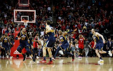 HOUSTON, TEXAS - FEBRUARY 09: Donovan Mitchell #45 of the Utah Jazz and Rudy Gobert #27 congratulate Bojan Bogdanovic #44 after a game winning basket in the fourth quarter against the Houston Rockets at Toyota Center on February 09, 2020 in Houston, Texas.  NOTE TO USER: User expressly acknowledges and agrees that, by downloading and or using this photograph, User is consenting to the terms and conditions of the Getty Images License Agreement. (Photo by Tim Warner/Getty Images)