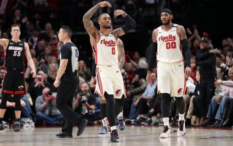 PORTLAND, OREGON - FEBRUARY 09: Damian Lillard #0 of the Portland Trail Blazers celebrates in the fourth quarter against the Miami Heat during their game at Moda Center on February 09, 2020 in Portland, Oregon. NOTE TO USER: User expressly acknowledges and agrees that, by downloading and or using this photograph, User is consenting to the terms and conditions of the Getty Images License Agreement. (Photo by Abbie Parr/Getty Images)