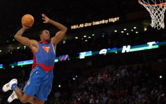 Dwight Howard of the Orlando Magic jumps wearing a Superman Cape in the Sprite Slam-Dunk Contest at the New Orleans Arena during the 2008 NBA All-Star Weekend February 16, 2008 in New Orleans, Louisiana. Howard won the contest with his series of dunks.  AFP PHOTO    TIMOTHY A. CLARY (Photo credit should read TIMOTHY A. CLARY/AFP via Getty Images)