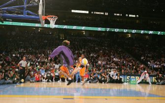 DENVER - FEBRUARY 19:  Steve Nash #13 of the Phoenix Suns passes to Amare Stoudemire #32 in the Sprite Rising Stars Slam Dunk Competition during 2005 NBA All-Star Weekend at the Pepsi Center in Denver, Colorado on February 19, 2005.  NOTE TO USER:  User expressly acknowledges and agrees that, by downloading and/or using this Photograph, user is consenting to the terms and conditions of the Getty Images License Agreement. Mandatory Copyright Notice: Copyright 2005 NBAE (Photo by Jesse D. Garrabrant/NBAE via Getty Images) *** Local Caption *** Steve Nash;Amare Stoudemire