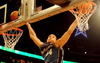 JaVale McGee from the Washington Wizards slam dunks two balls before finishing runner-up during the All-Stars Slam Dunk contest at the Staples Center in Los Angeles on February 19, 2011. The event took place ahead of Sunday's 60th NBA All-Star Game showdown between Eastern and Western conference superstars at Los Angeles on February 20.        AFP PHOTO/Mark RALSTON (Photo credit should read MARK RALSTON/AFP via Getty Images)