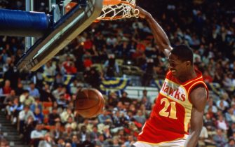 CHICAGO - FEB 6: Dominique Wilkins #21 of the Atlanta Hawks goes for a dunk during the Gatorade Slam Dunk Championship during the 1988 NBA All-Star Weekend at Chicago Stadium on February 6, 1988 in Chicago, Illinois. NOTE TO USER: User expressly acknowledges and agrees that, by downloading and or using this photograph, User is consenting to the terms and conditions of the Getty Images License Agreement.  Mandatory Copyright Notice: Copyright 2004 NBAE  (Photo by Andrew D. Bernstein/NBAE via Getty Images)