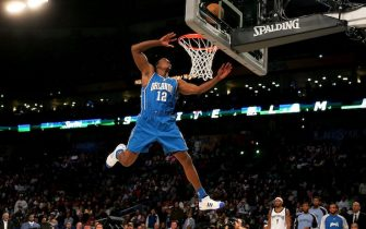 NEW ORLEANS - FEBRUARY 16:  Dwight Howard of the Orlando Magic completes a dunk in the Sprite Slam Dunk Contest, part of 2008 NBA All-Star Weekend at the New Orleans Arena on February 16, 2008 in New Orleans, Louisiana.  NOTE TO USER: User expressly acknowledges and agrees that, by downloading and or using this photograph, User is consenting to the terms and conditions of the Getty Images License Agreement.  (Photo by Ronald Martinez/Getty Images)