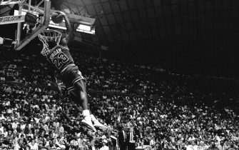 SEATTLE, WA - FEBRUARY 7: Michael Jordan #23 of the Chicago Bulls attempts a dunk during the 1987 Slam Dunk Contest on February 7, 1987 at Seattle Center Coliseum in Seattle, Washington. NOTE TO USER: User expressly acknowledges and agrees that, by downloading and or using this photograph, User is consenting to the terms and conditions of the Getty Images License Agreement. Mandatory Copyright Notice: Copyright 1987 NBAE (Photo by Nathaniel S. Butler/NBAE via Getty Images)