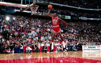 CHICAGO, IL - FEBRUARY 6: Michael Jordan #23 of the Chicago Bulls goes for a dunk during the 1988 NBA All Star Slam Dunk Competition on February 6, 1988 at Chicago Stadium in Chicago, Illinois. Jordan went on to win the Slam Dunk Competition.  HIGH RESOLUTION FILE 42 MB. NOTE TO USER: User expressly acknowledges and agrees that, by downloading and/or using this Photograph, User is consenting to the terms and conditions of the Getty Images License Agreement. Mandatory copyright notice and Credit: Copyright 2001 NBAE  Mandatory Credit: Andrew D. Bernstein/NBAE/Getty Images