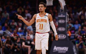 ORLANDO, FLORIDA - FEBRUARY 10: Trae Young #11 of the Atlanta Hawks points to the bench in the first half against the Orlando Magic at Amway Center on February 10, 2020 in Orlando, Florida.  NOTE TO USER: User expressly acknowledges and agrees that, by downloading and/or using this photograph, user is consenting to the terms and conditions of the Getty Images License Agreement.  (Photo by Mark Brown/Getty Images)