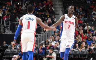 DETROIT, MI - FEBRUARY 10: Reggie Jackson #1, and Thon Maker #7 of the Detroit Pistons hi-five each other during the game against the Charlotte Hornets on February 10, 2020 at Little Caesars Arena in Detroit, Michigan. NOTE TO USER: User expressly acknowledges and agrees that, by downloading and/or using this photograph, User is consenting to the terms and conditions of the Getty Images License Agreement. Mandatory Copyright Notice: Copyright 2020 NBAE (Photo by Chris Schwegler/NBAE via Getty Images)