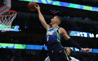 DALLAS, TEXAS - FEBRUARY 10:  Kristaps Porzingis #6 of the Dallas Mavericks drives the hoop against the Utah Jazz in the second half at American Airlines Center on February 10, 2020 in Dallas, Texas.  NOTE TO USER: User expressly acknowledges and agrees that, by downloading and or using this photograph, User is consenting to the terms and conditions of the Getty Images License Agreement. (Photo by Ronald Martinez/Getty Images)