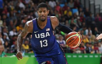 RIO DE JANEIRO, BRAZIL - AUGUST 10:  Paul George #13 of the USA Basketball Men's National Team drives to the basket against Australia on Day 5 of the Rio 2016 Olympic Games on August 10, 2016 at Barra Carioca Arena 1 in Rio de Janerio, Brazil. NOTE TO USER: User expressly acknowledges and agrees that, by downloading and or using this photograph, user is consenting to the terms and conditions of Getty Images License Agreement. Mandatory Copyright Notice: Copyright 2016 NBAE (Photo by Jesse D. Garrabrant/NBAE via Getty Images)