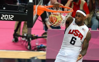 US forward LeBron James scores during the London 2012 Olympic Games men's gold medal basketball game between USA and Spain at the North Greenwich Arena in London on August 12, 2012.           AFP PHOTO / MARTIN BUREAU        (Photo credit should read MARTIN BUREAU/AFP/GettyImages)