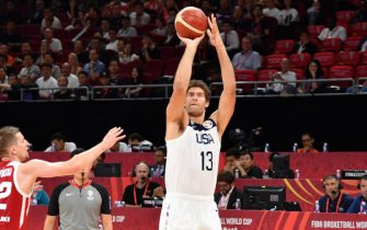 BEIJING, CHINA - SEPTEMBER 14: Brook Lopez #13 of Team USA shoots three point basket against Team Poland during the 2019 FIBA World Cup Classification 7-8 at the Cadillac Arena on September 14, 2019 in Beijing, China.  NOTE TO USER: User expressly acknowledges and agrees that, by downloading and/or using this Photograph, user is consenting to the terms and conditions of the Getty Images License Agreement. Mandatory Copyright Notice: Copyright 2019 NBAE (Photo by Jesse D. Garrabrant/NBAE via Getty Images)