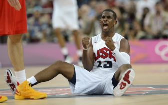 US guard Chris Paul celebrates during the London 2012 Olympic Games men's gold medal basketball game between USA and Spain at the North Greenwich Arena in London on August 12, 2012.            AFP PHOTO / TIMOTHY A.  CLARY        (Photo credit should read TIMOTHY A. CLARY/AFP/GettyImages)