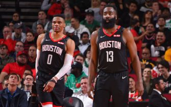 HOUSTON, TX - FEBRUARY 11: Russell Westbrook #0 of the Houston Rockets and James Harden #13 of the Houston Rockets look on during a game against the Boston Celtics on February 11, 2020 at the Toyota Center in Houston, Texas. NOTE TO USER: User expressly acknowledges and agrees that, by downloading and or using this photograph, User is consenting to the terms and conditions of the Getty Images License Agreement. Mandatory Copyright Notice: Copyright 2020 NBAE (Photo by Bill Baptist/NBAE via Getty Images)