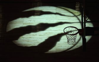 TORONTO, ON - JANUARY 26: A view of a spotlit logo on the court floor before the start of the Toronto Raptors NBA game against the Utah Jazz at Air Canada Centre on January 26, 2018 in Toronto, Canada. NOTE TO USER: User expressly acknowledges and agrees that, by downloading and or using this photograph, User is consenting to the terms and conditions of the Getty Images License Agreement. (Photo by Tom Szczerbowski/Getty Images) *** Local Caption ***