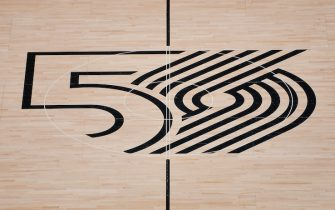 PORTLAND, OREGON - NOVEMBER 29: A general view of the Portland Trail Blazers center court logo celebrating the 50th anniversary season before the game against the Chicago Bulls at the Moda Center on November 29, 2019 in Portland, Oregon.  NOTE TO USER: User expressly acknowledges and agrees that, by downloading and or using this photograph, User is consenting to the terms and conditions of the Getty Images License Agreement.  (Photo by Alika Jenner/Getty Images)