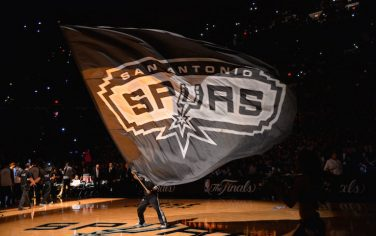SAN ANTONIO, TX - JUNE 5: Mascot of the San Antonio Spurs holds the logo up during a timeout against the Miami Heat during Game One of the 2014 NBA Finals on June 5, 2014 at AT&T Center in San Antonio, Texas. NOTE TO USER: User expressly acknowledges and agrees that, by downloading and or using this photograph, User is consenting to the terms and conditions of the Getty Images License Agreement. Mandatory Copyright Notice: Copyright 2014 NBAE (Photo by Jesse D. Garrabrant/NBAE via Getty Images)